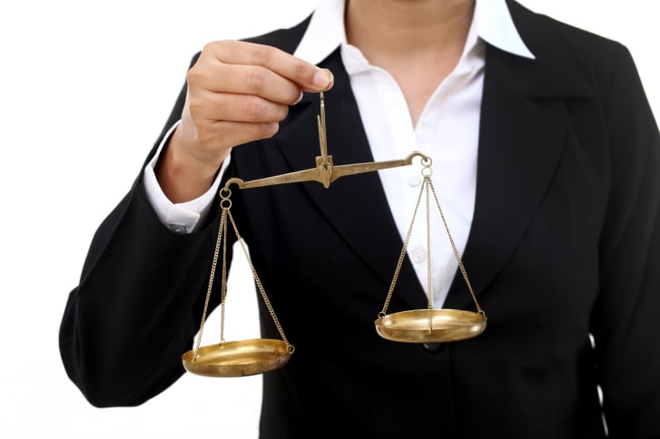 manager-weighing-pros-cons-hiring-greedy-salespeople