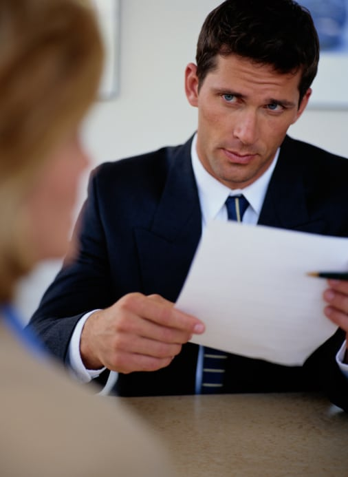 Sales manager scrutinizing a job applicant